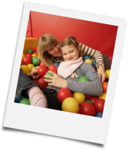 Photo: Mother and daughter playing in a soft ball pit courtesy of Together for Short Lives